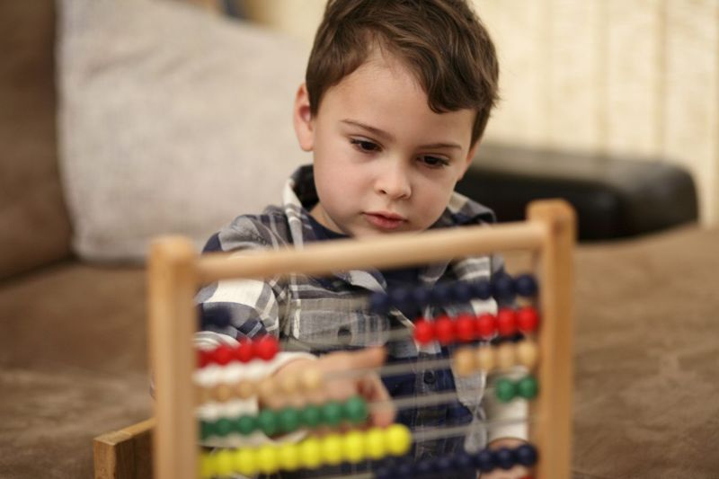 child counting abacus