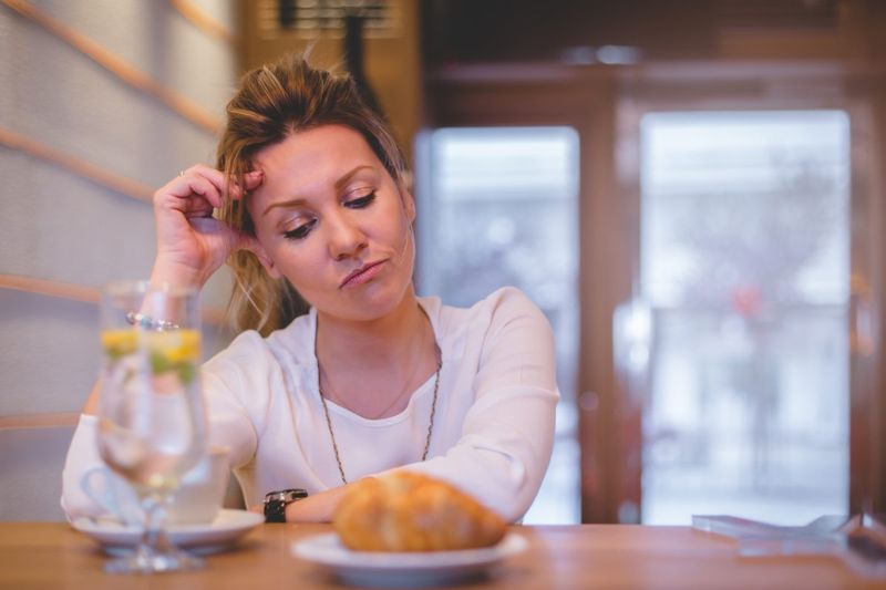 woman frowning food