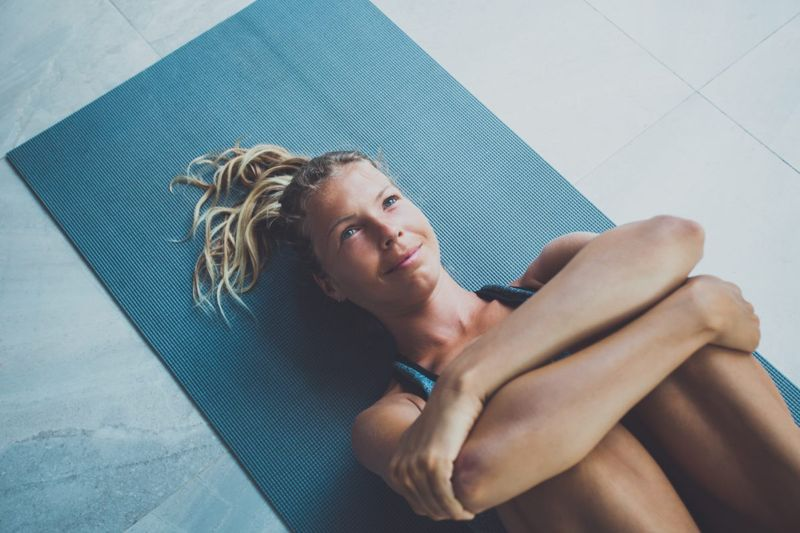 Woman performing recover stretch