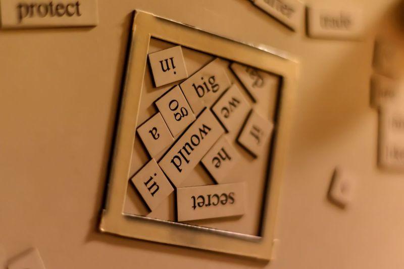 Wordplay tiles on fridge