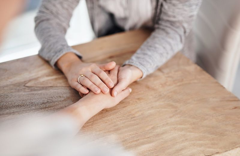 Smart person holding hands for support
