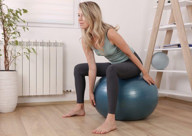 woman exercising pelvic muscles