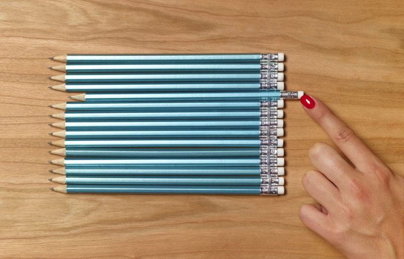 Smart perfectionist lining up pencils
