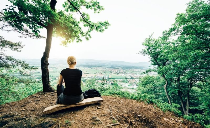 woman sitting forest