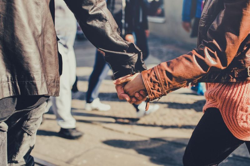 leather jackets hand holding