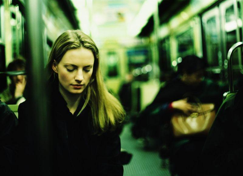 Smart woman sitting quietly on public transport