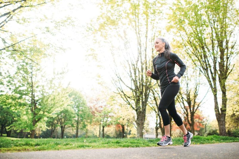 woman jogging park health