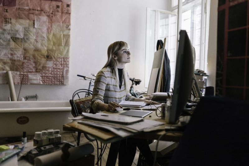 softly lit woman home office