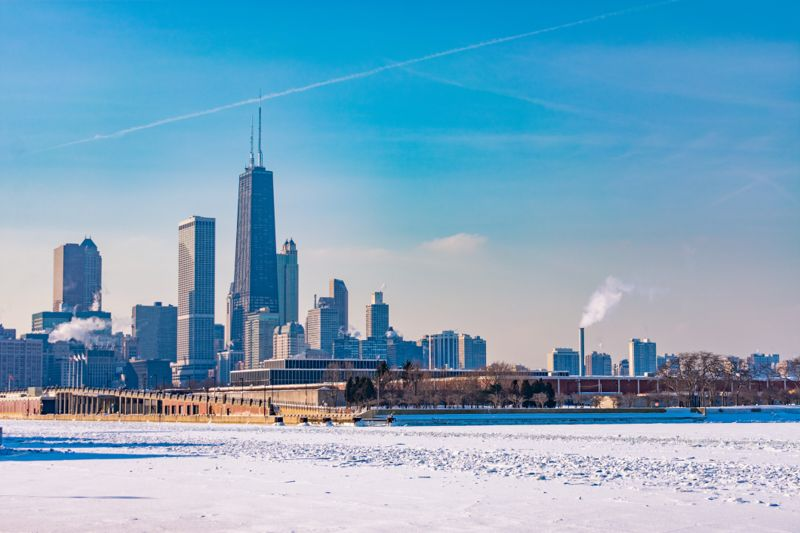 A Chicago skyline view with snow and ice covering Lake Michigan after a Polar Vortex