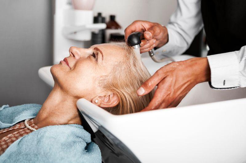 Hair stylist washing hair