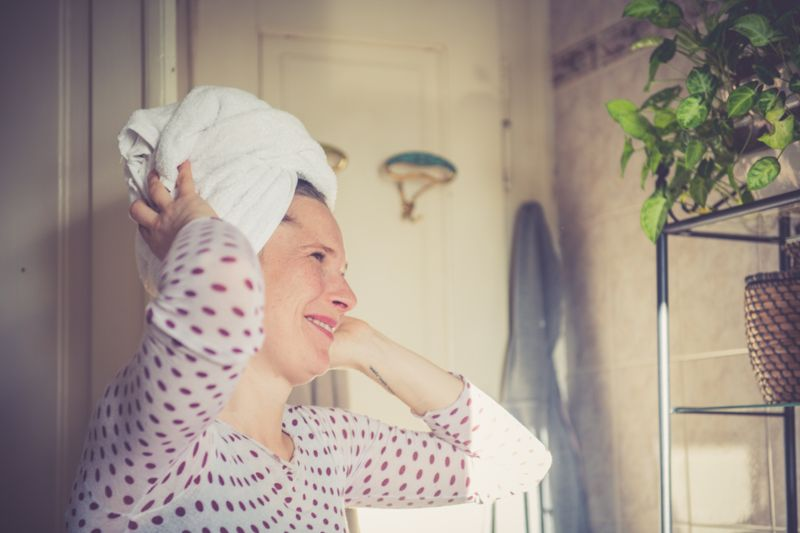 Woman with Wrapped wet hair in a towel