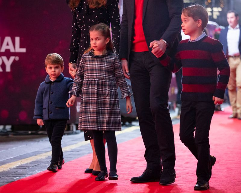 Prince William, Duke of Cambridge and Catherine, Duchess of Cambridge with their children, Prince Louis, Princess Charlotte and Prince George, attend a special pantomime performance at London's Palladium Theatre, hosted by The National Lottery, to thank key workers and their families for their efforts throughout the pandemic on December 11, 2020 in London, England.