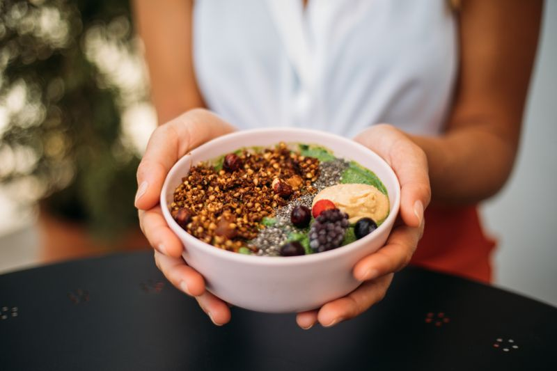 Woman eating smoothie bowl