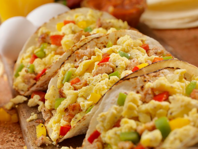 Soft Breakfast Taco with Scrambled Eggs, Sausage,Peppers and Cheddar Cheese