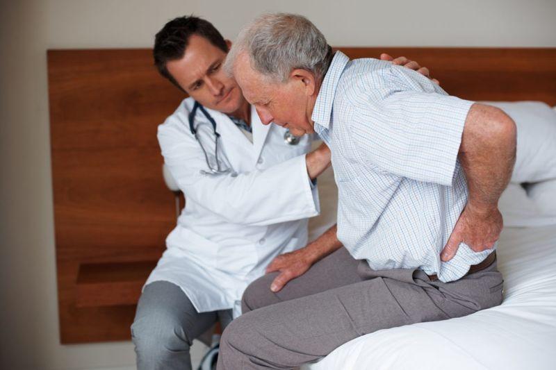 doctor older patient back