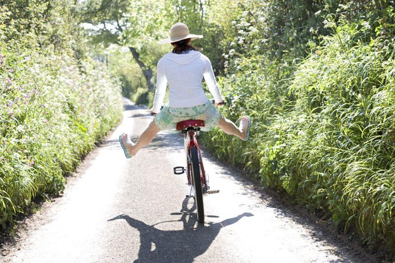 woman cycling balancing legs