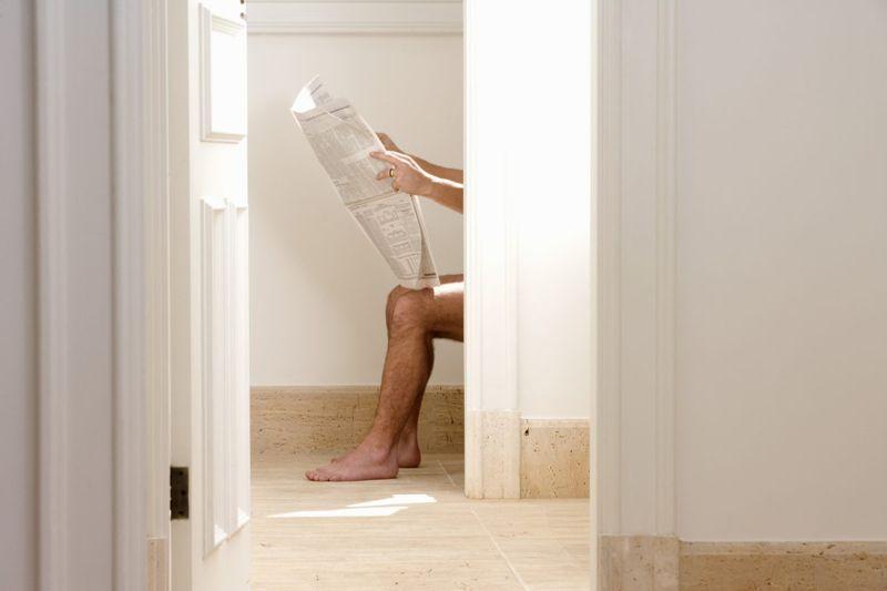man sitting toilet
