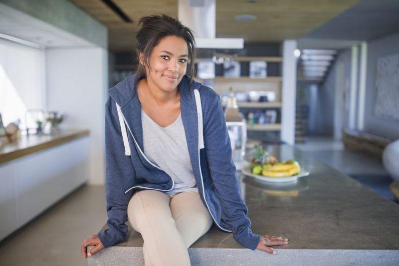 woman sitting wool activewear