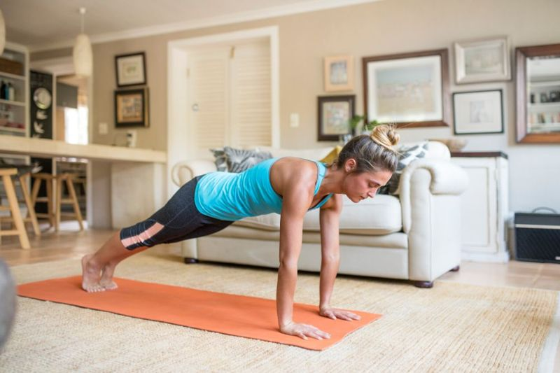 woman in plank position exercise from hands