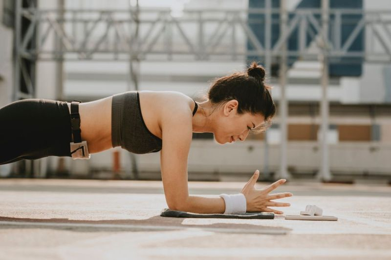 woman in plank pose head in line with spine