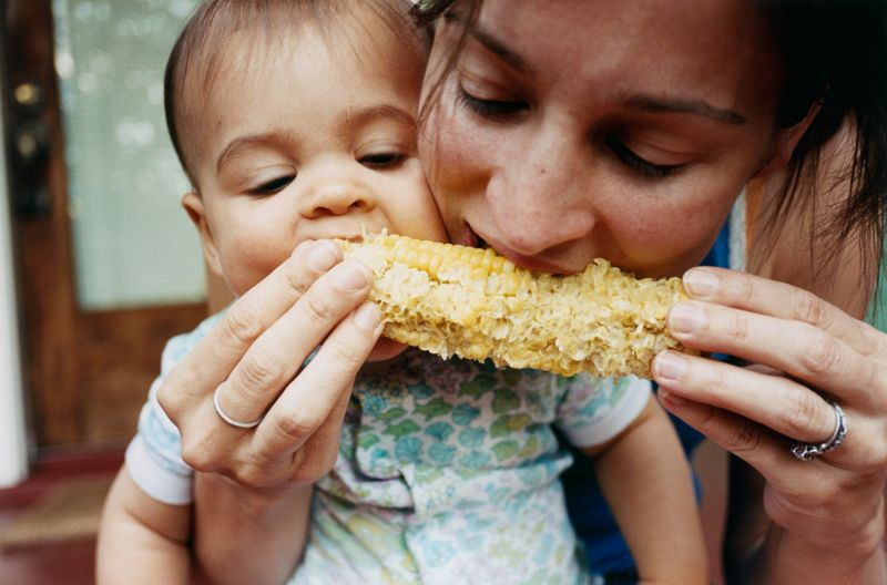 Mother and Baby Eating Corn