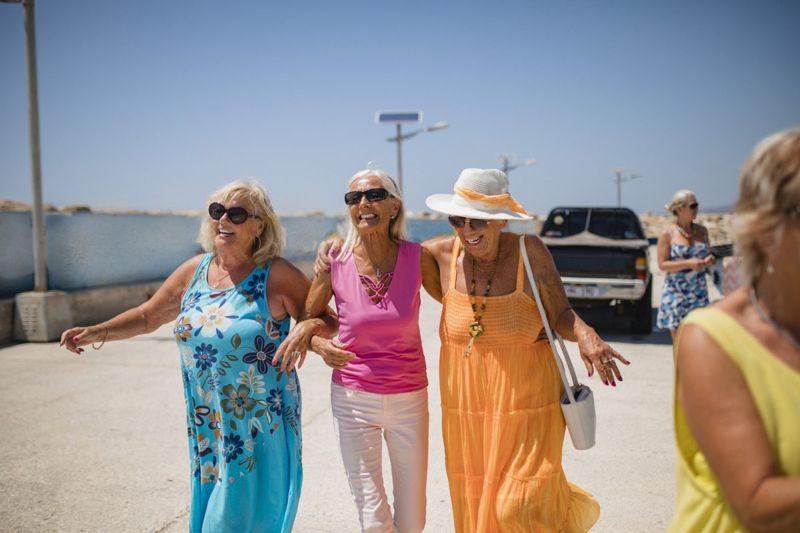 Several senior women walking together.