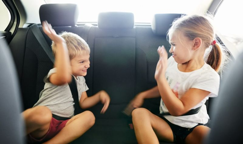 Young children fussing in vehicle.