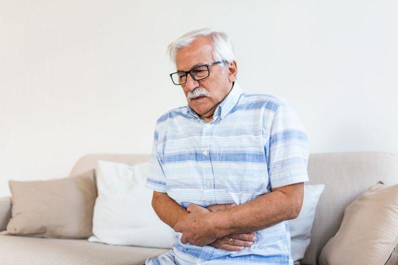 pain stomach sitting