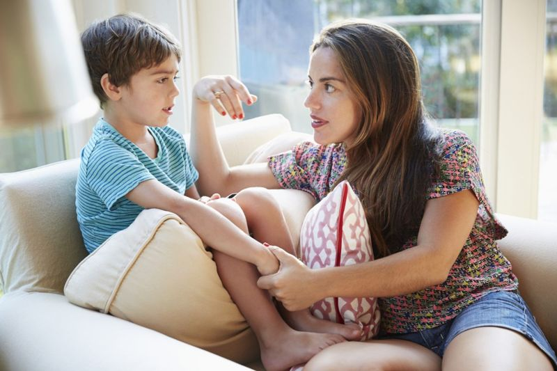 Parent talking with child.