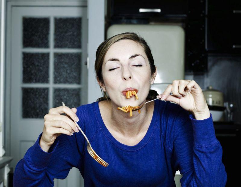 Woman eating spaghetti.