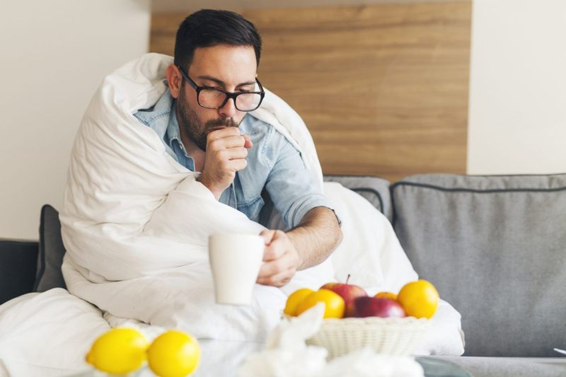 man coughing after drinking