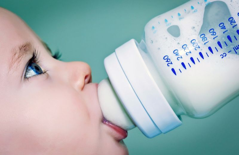 Baby drinking from bottle.