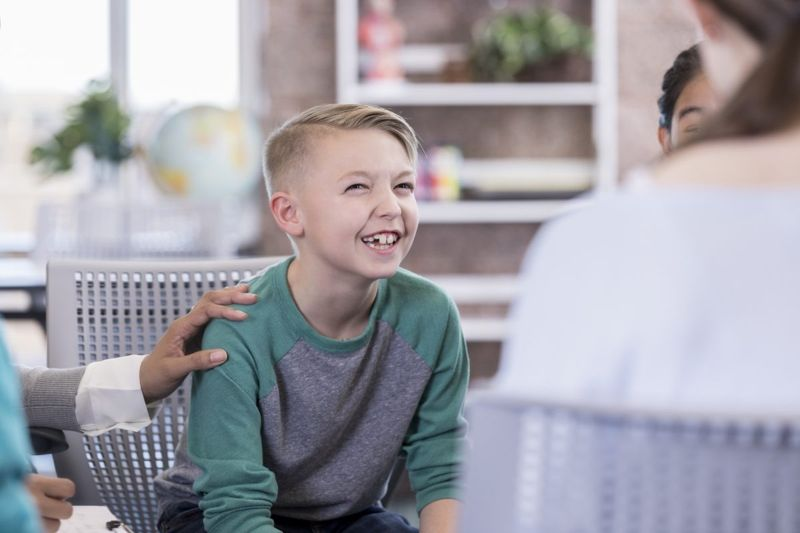 Child working with a therapist.