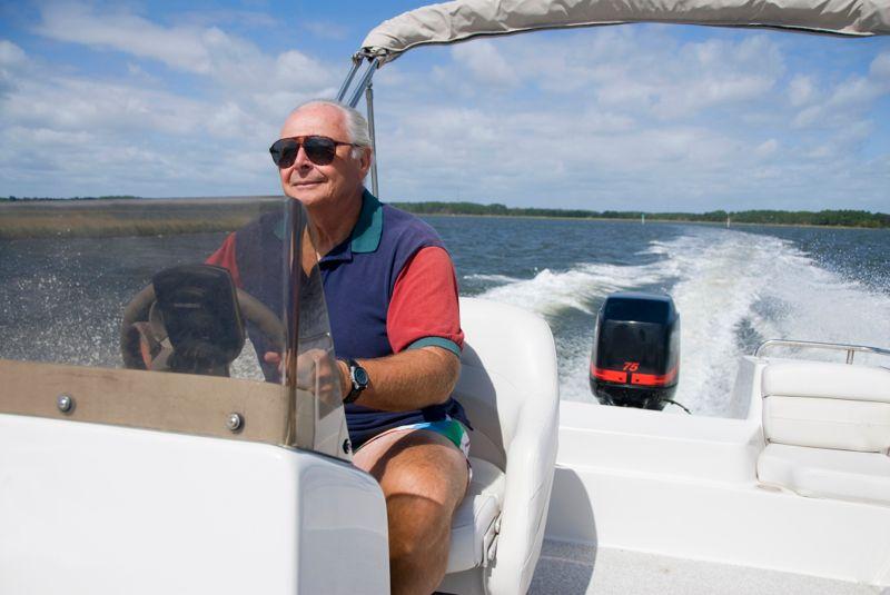 Senior man steering a motor boat