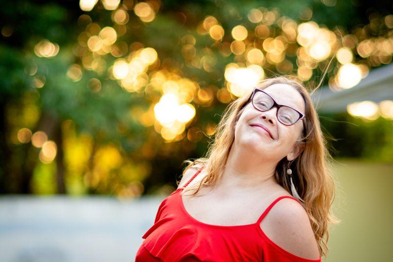 Shot of a woman, looking at camera and smiling