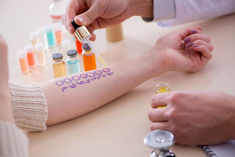 person getting allergy test on forearm