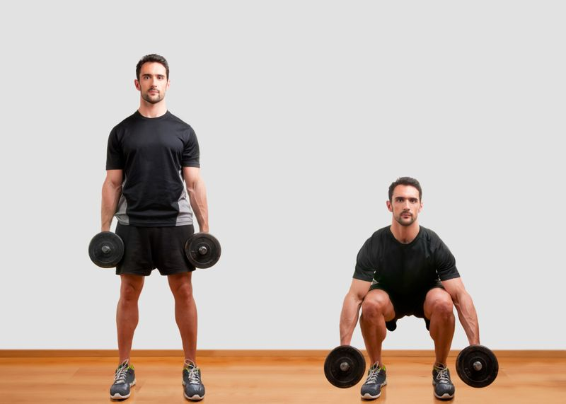 man showing how to do a dumbbell squat