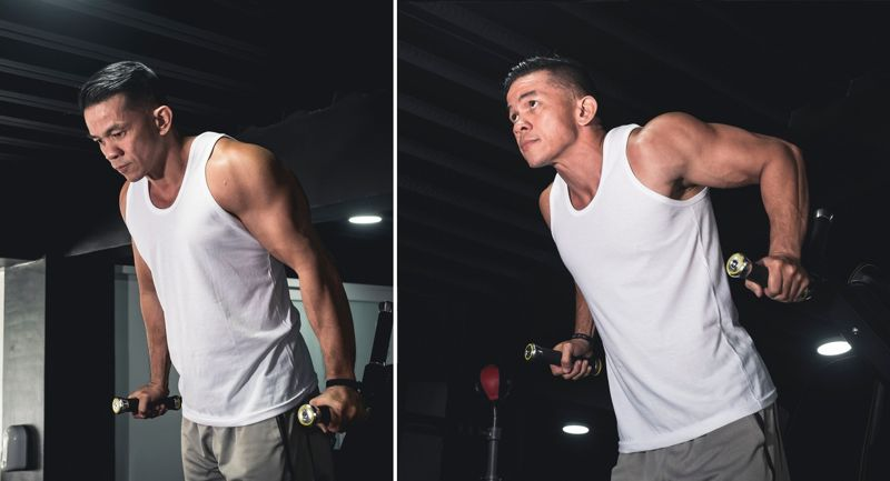 man using dip station to perform calisthenics exercise