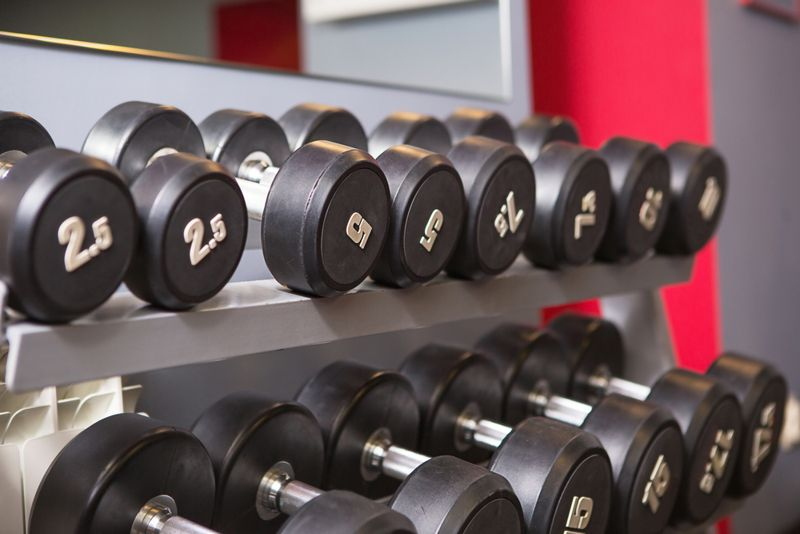 a rack of dumbbells of different weights