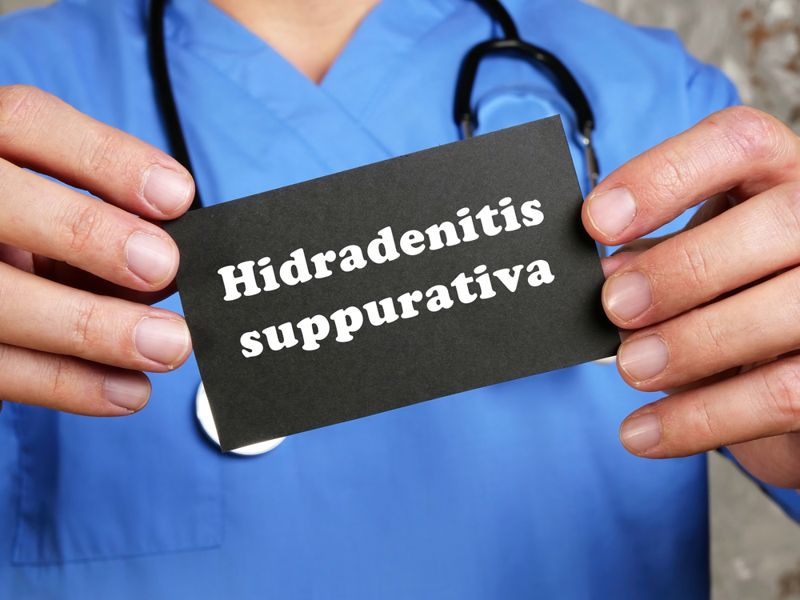 doctor holding sign with Hidradenitis Suppurativa