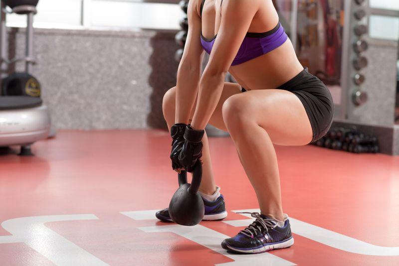 kettlebell workout woman in gym closeup