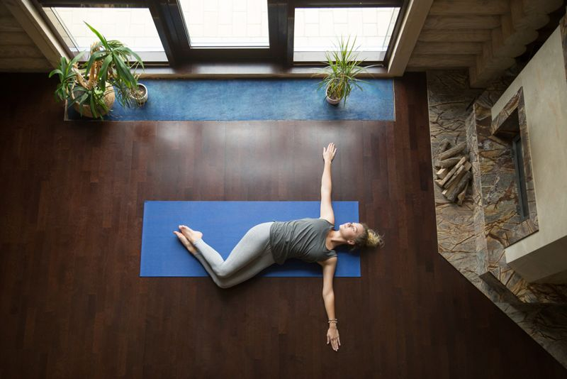 overhead view of a woman doing a supine spinal twist