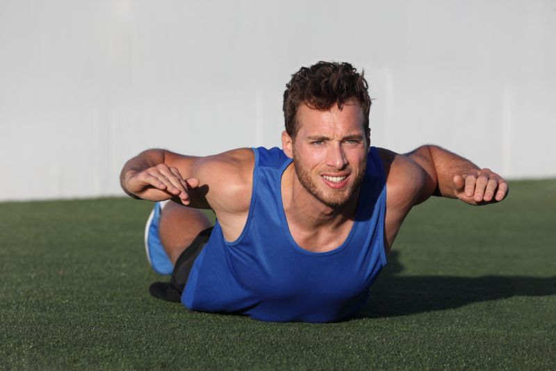 man doing trunk lift or superman exercise