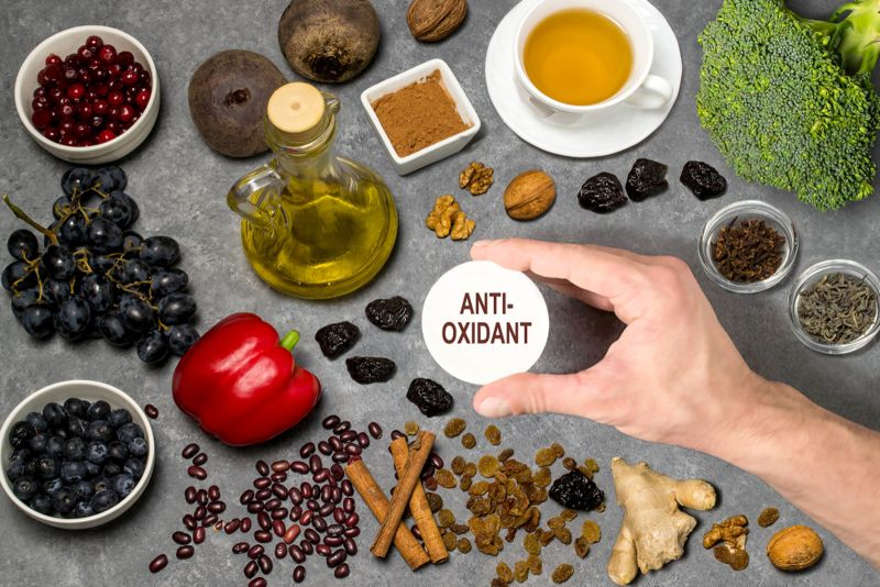 foods with antioxidants on a grey background