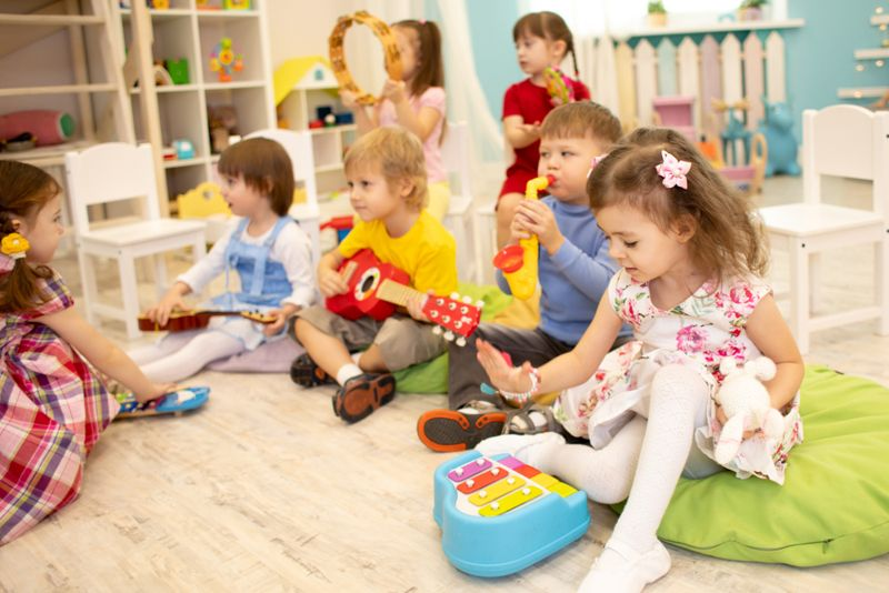 children at daycare playing musical instruments