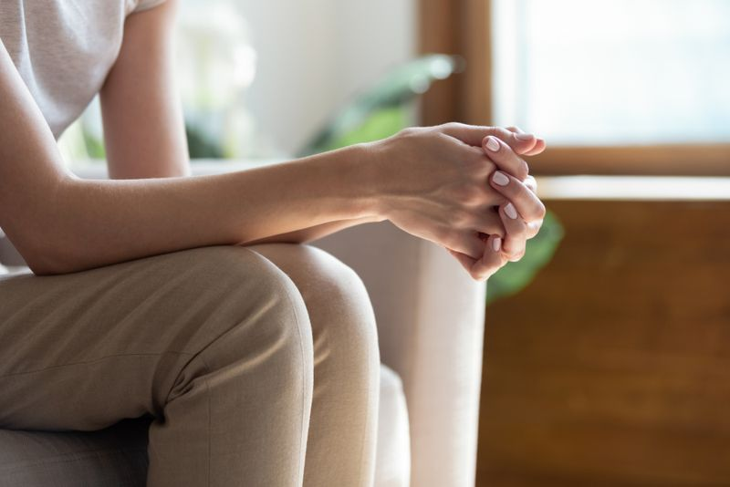 close up crop of woman clasping her hands