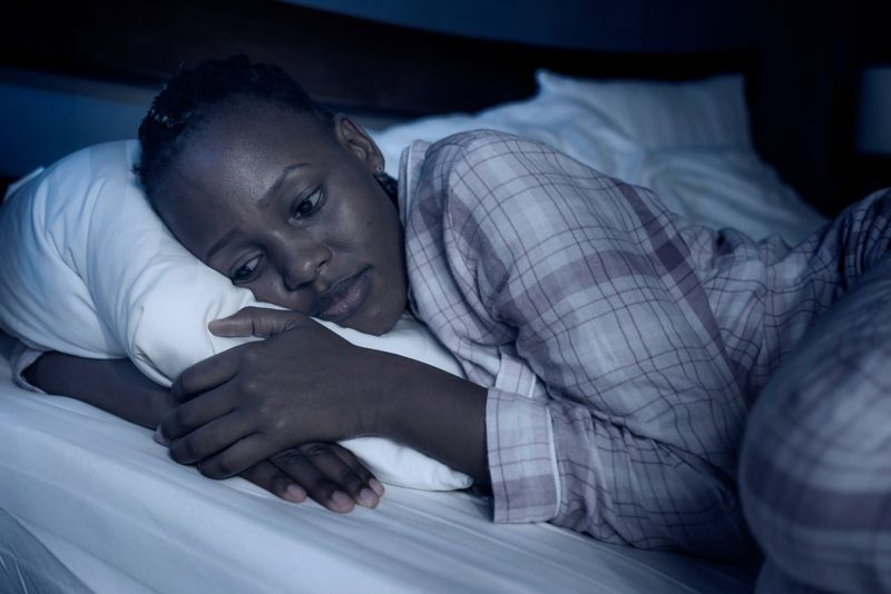 sad woman in bed can't sleep