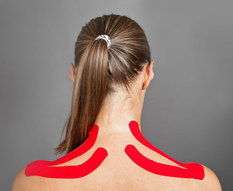 woman with kinesio tape along her upper trapezius shoulders