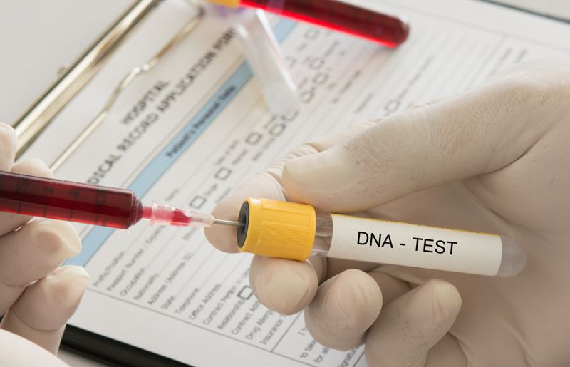 dna concept image with blood and test tube