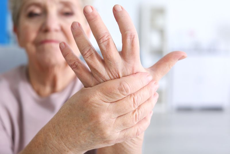 older woman holding out her sore hand